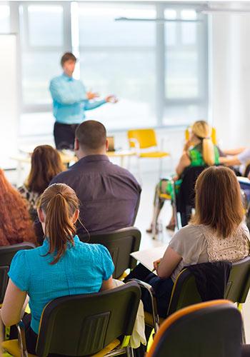 Teacher-presenting-class